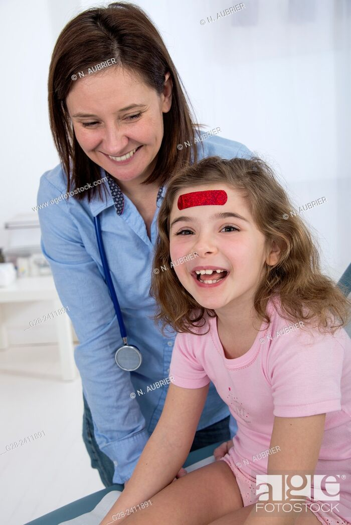 Stock Photo: Pediatrist doctor and laughing little girl with a red dressing on her forehead.