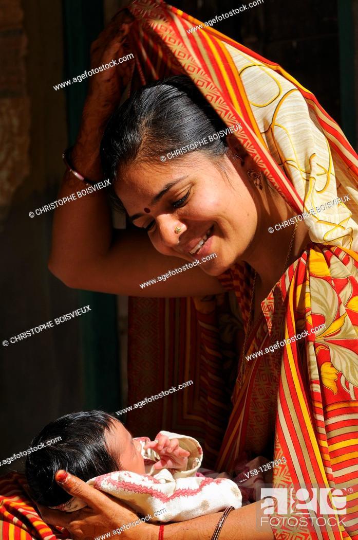 Stock Photo: India, Rajasthan, Shekhawati, Mandawa, Young mother with her newborn baby.