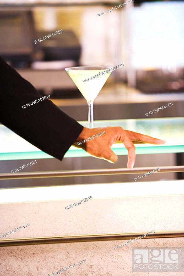 Stock Photo: Glass of martini on the table.
