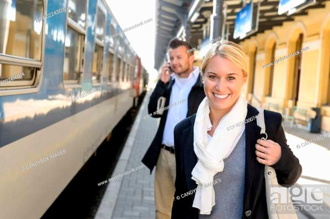 Stock Photo: Woman smiling in train station man phone.