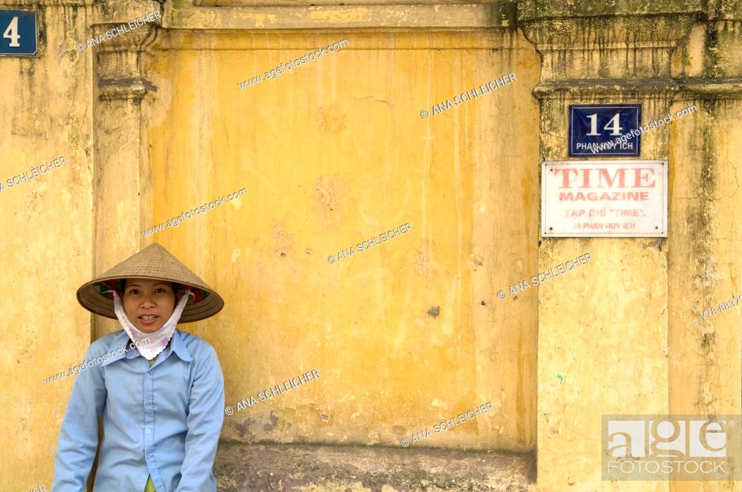 Stock Photo: Woman resting on a wall, Hanoi, Vietnam.