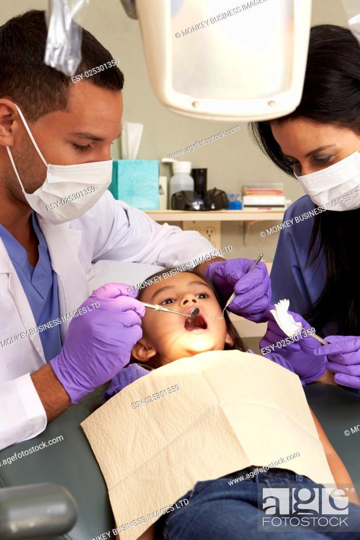 Stock Photo: Young Girl Having Check Up At Dentists Surgery.