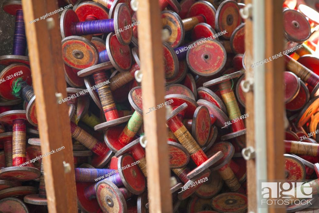 Stock Photo: making cotton threads on spools in fabric factory in Mandalay Myanmar.