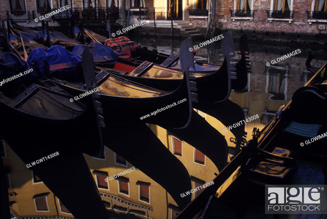 Stock Photo: Reflection of gondolas and a building in water, Italy.