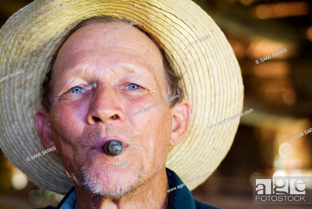 Stock Photo: Portrait of a mature tobacco farmer smoking a cigar, Vinales, Pinar del Rio Province, Cuba.