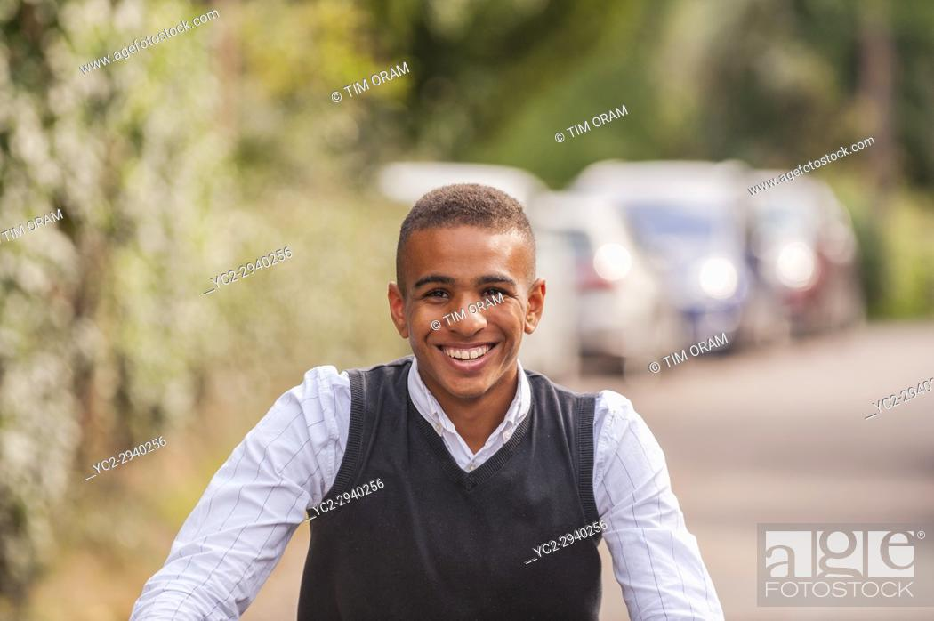 Stock Photo: A teenage boy of 17 on his bike in the Uk.