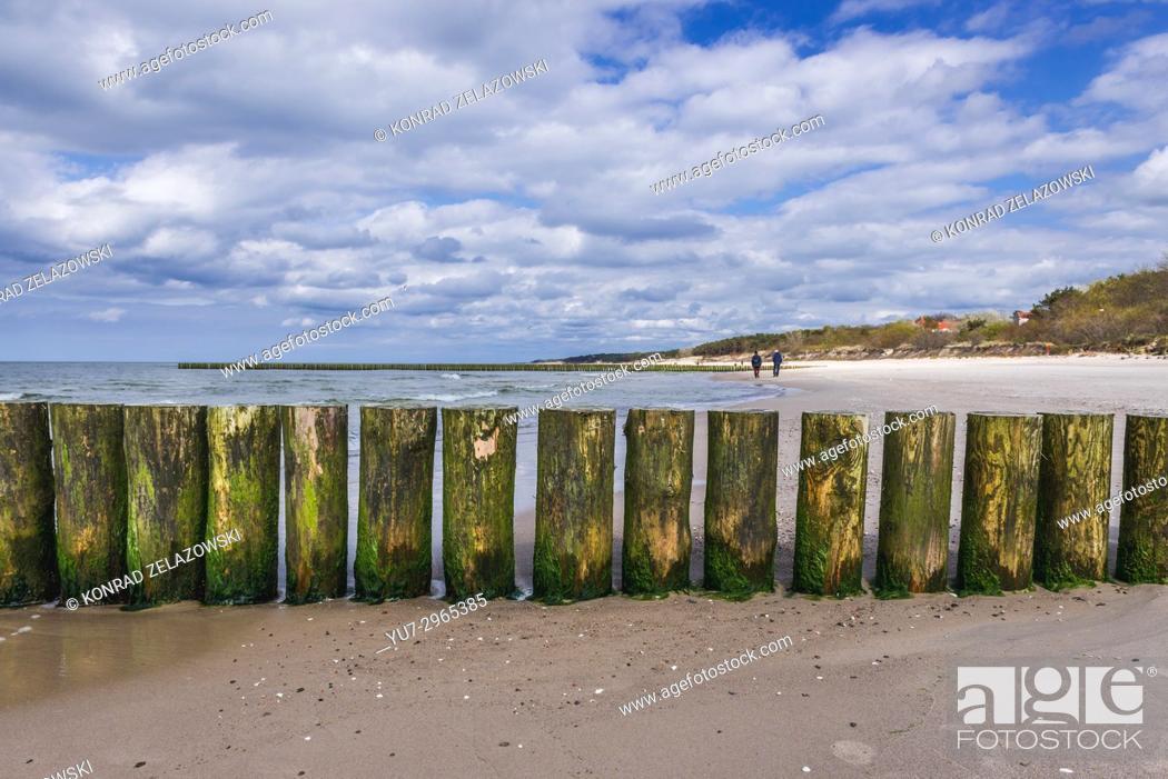 Stock Photo: Wooden breakwater in Niechorze village in West Pomeranian Voivodeship of Poland.
