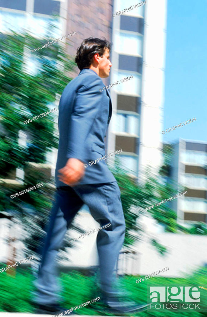 Stock Photo: Young businessman walking.