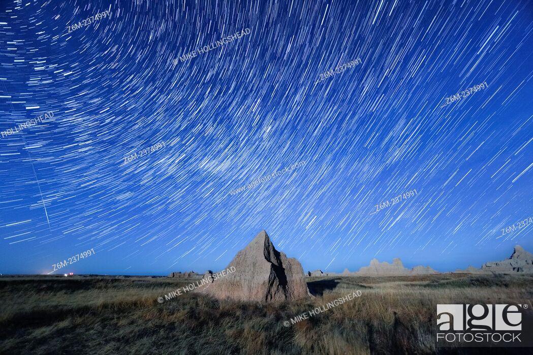 Stock Photo: Stars trail over the Badlands of South Dakota.