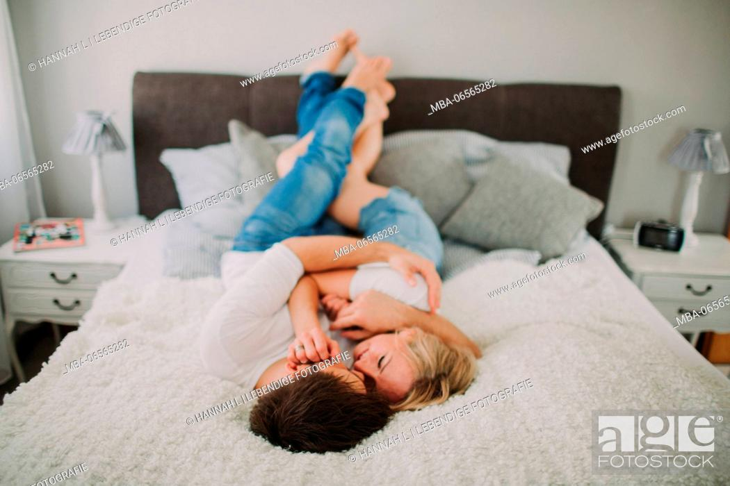 Stock Photo: Young couple in love at home in the bed.