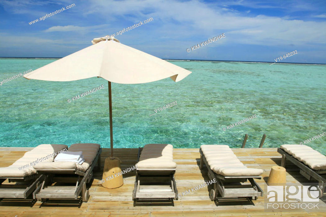Stock Photo: White Umbrella on Beachside, Maldives.