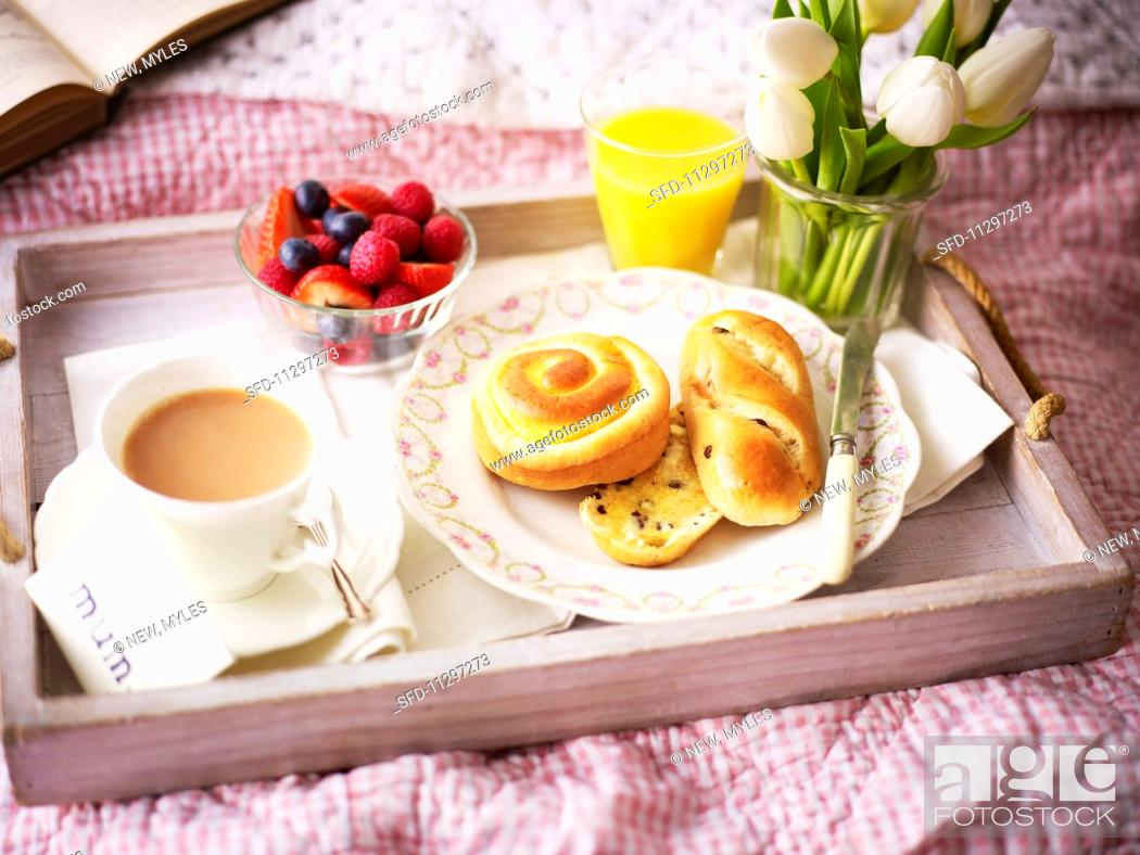 Stock Photo: A breakfast tray with white tulips.