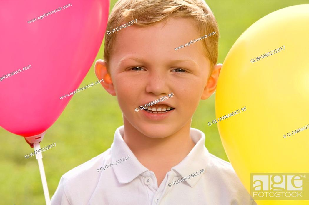 Stock Photo: Portrait of a boy with balloons.