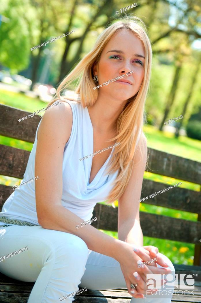 Stock Photo: Pensive mood - woman on bench.