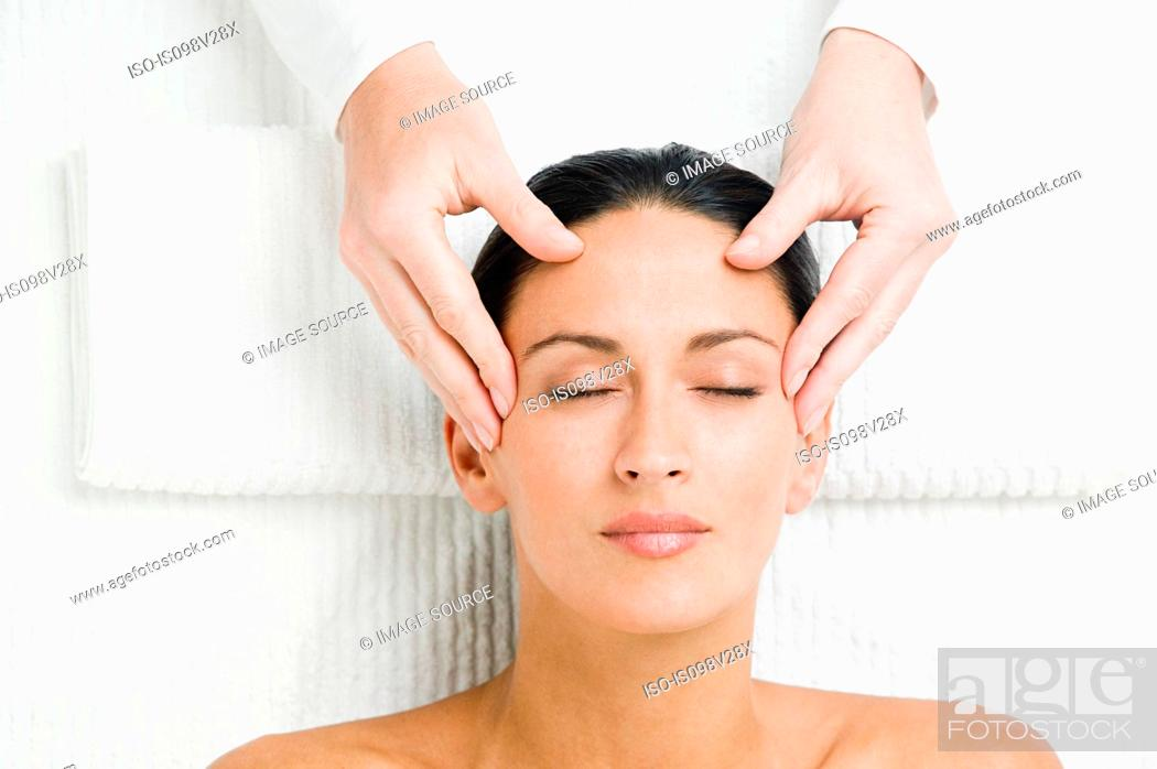 Stock Photo: Young woman having head massage.