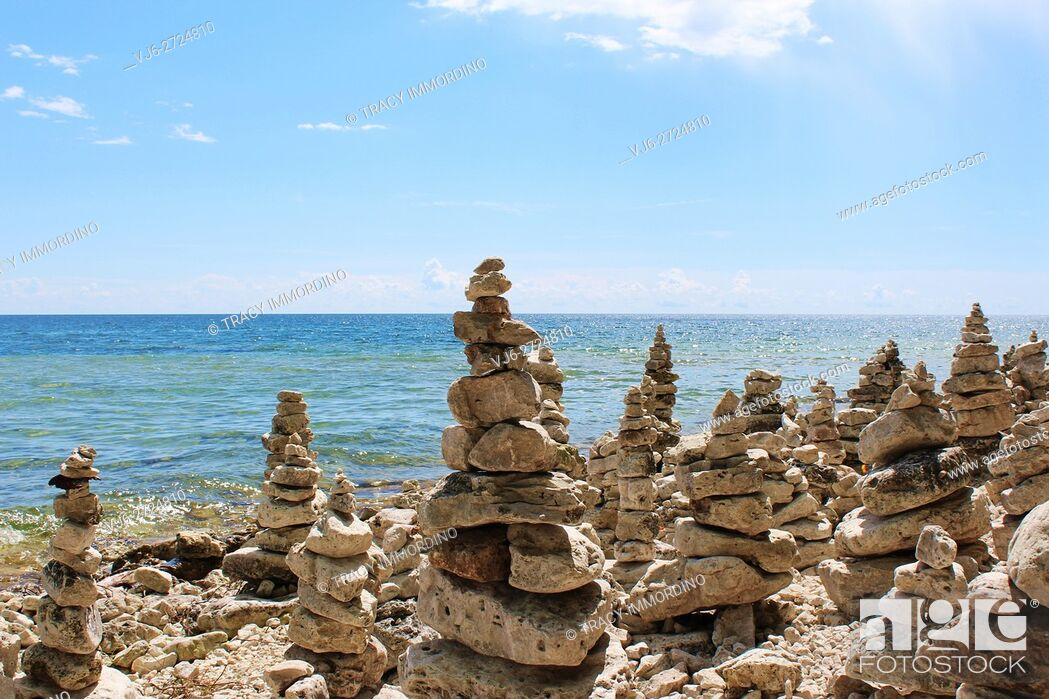 Stock Photo: A large collection of rock totems, cairns, lining Lake Michigan's shoreline at Cave Point County Park, Sturgeon Bay, Door County, Wisconsin, USA.