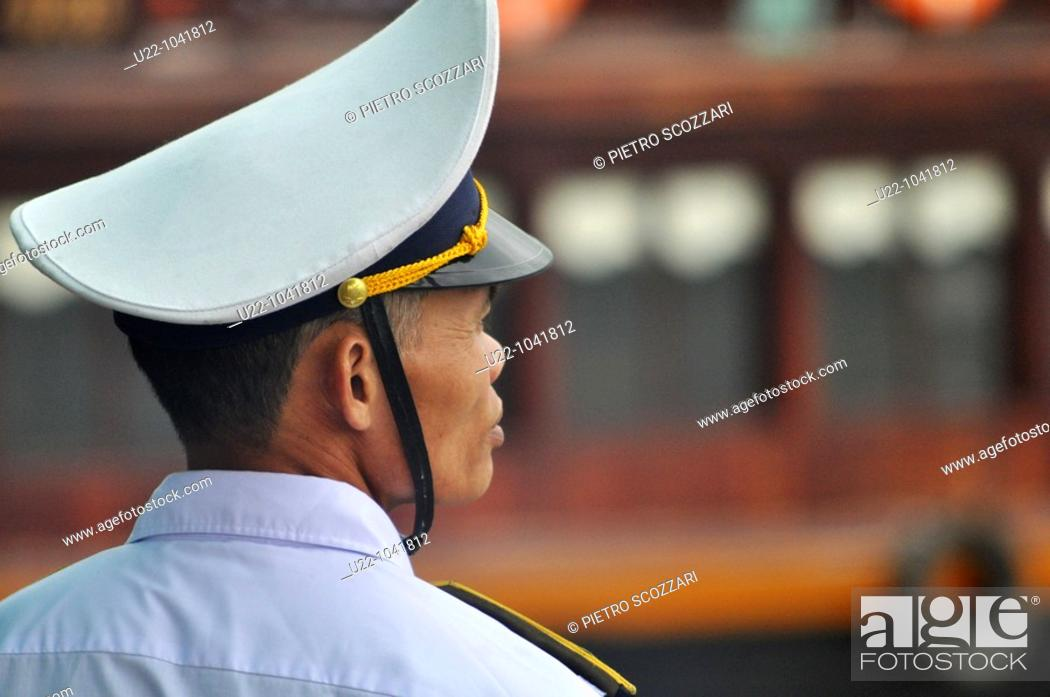 Stock Photo: Halong Bay (Vietnam): a boats traffic inspector in uniform.
