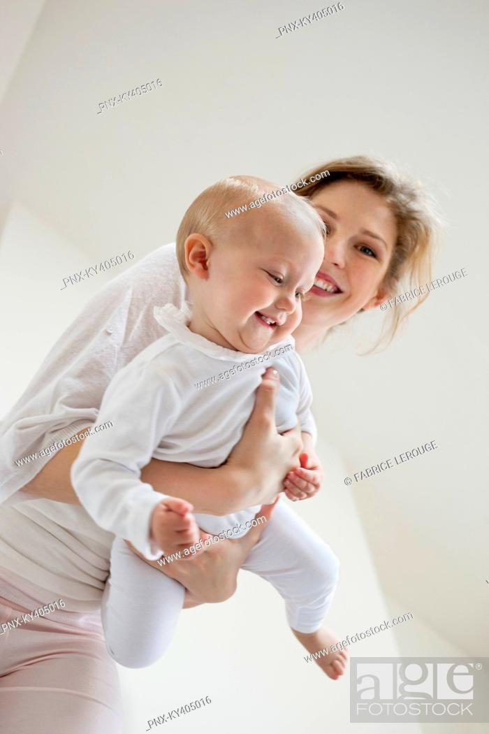 Stock Photo: Woman playing with her daughter and smiling.