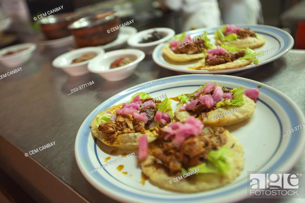 Stock Photo: Close-up shot of traditional tacos with chicken and meat on the table ready for serving at a restaurant, Merida, Riviera Maya, Yucatan State, Mexico.
