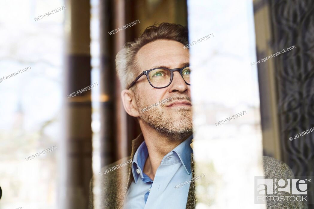 Stock Photo: Portrait of businessman looking at distance.