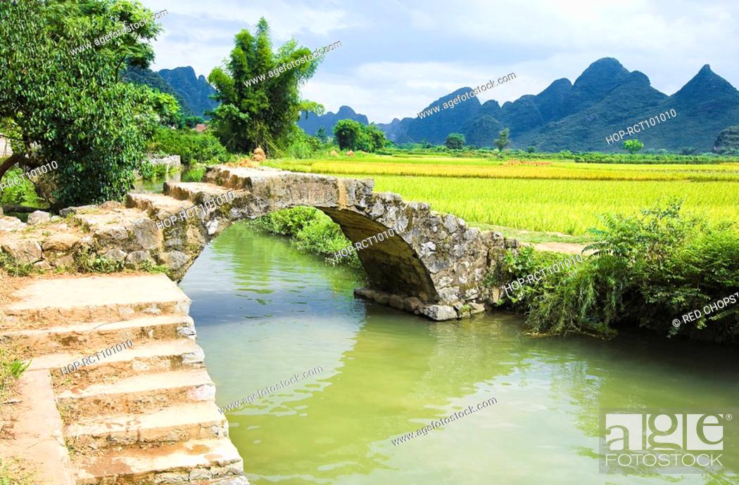 Stock Photo: Footbridge over a river, Yangshuo, Guangxi Province, China.