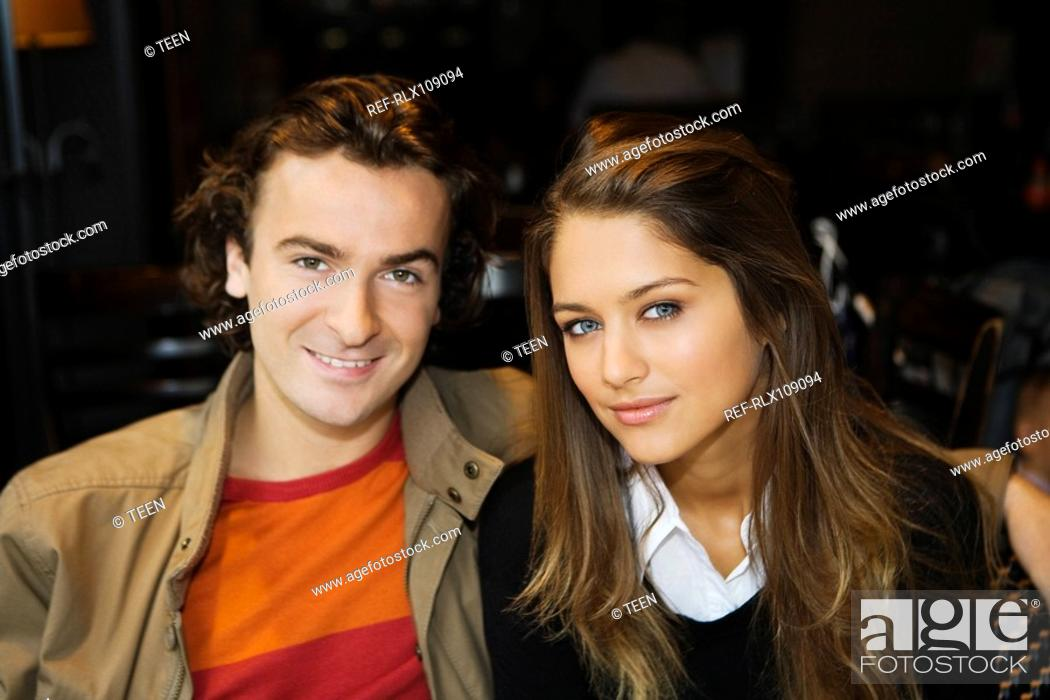 Stock Photo: Young couple in street cafe, Paris, France.