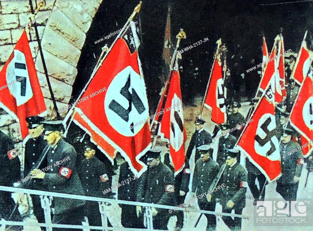 Stock Photo: banners carried by a Nazi uniformed unit circa 1933.