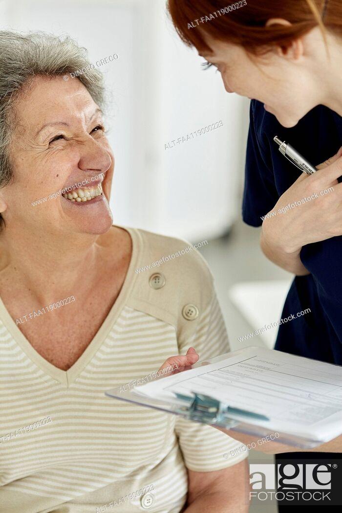 Stock Photo: Nurse talking to patient.