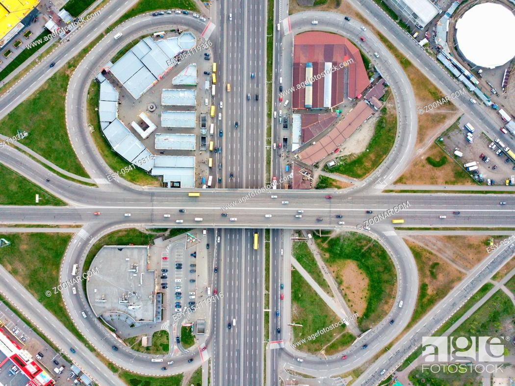 Stock Photo: Aerial view district Poznyaki, road junction with passing cars, parking, green area and buildings in sity Kiev, Ukraine. Photo from the drone.