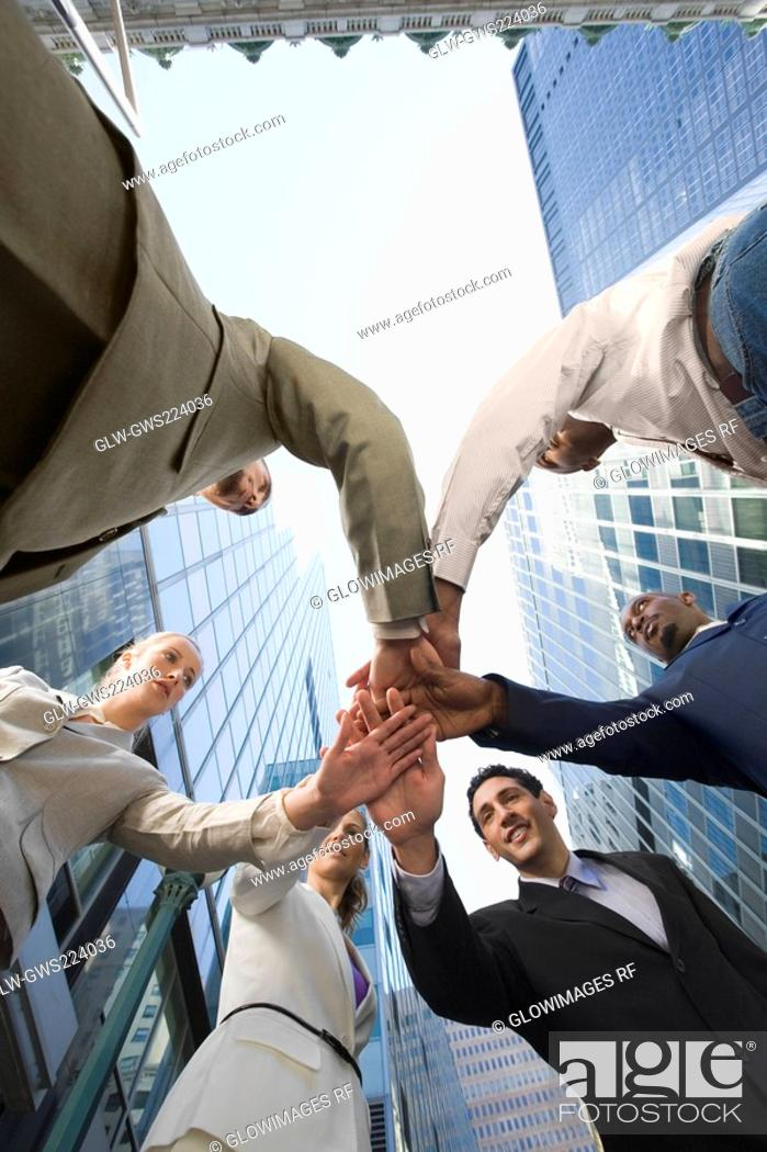 Stock Photo: Low angle view of business executives standing in a huddle.