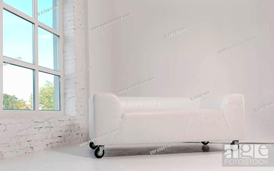Stock Photo: Modern White leather sofa with wheels in white room and big window.