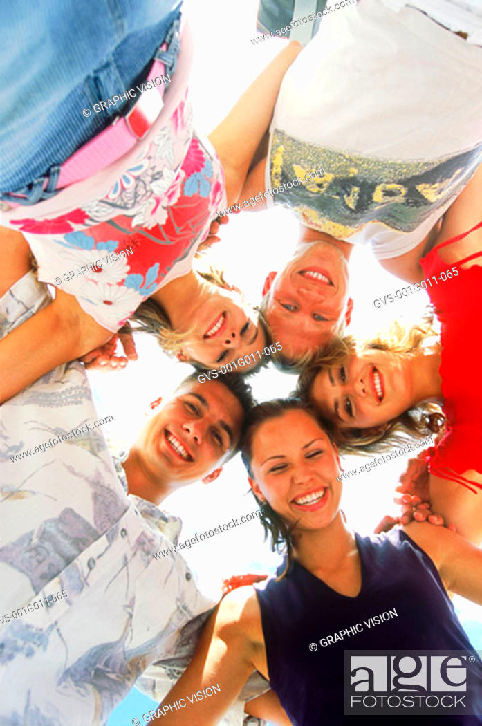 Stock Photo: Portrait of a group of young people in a huddle.
