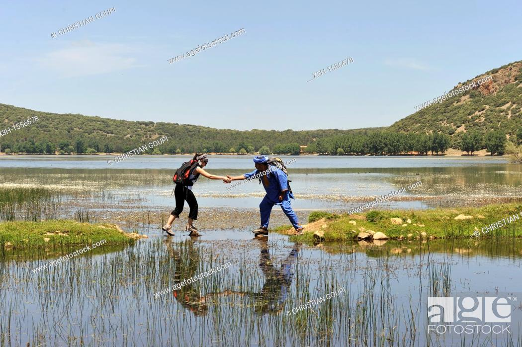 Stock Photo: hikers by the Dayet Aoua lake, around Ifrane, Middle Atlas, Morocco, North Africa.