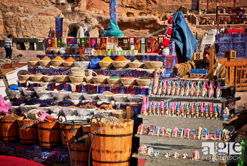 Stock Photo: Middle East. Egypt. Sharm El Sheikh. Local man at market stall. Close-up of spices and scents for sale.