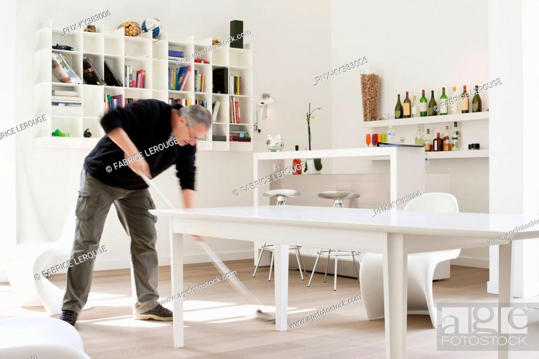 Stock Photo: Man mopping the floor.