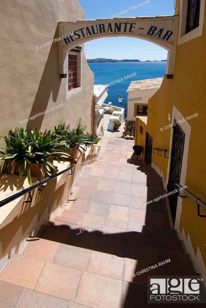 Stock Photo: Charming architecture and natural landscape in a mix on a sunny day in Cala Fornells, Mallorca, Spain.