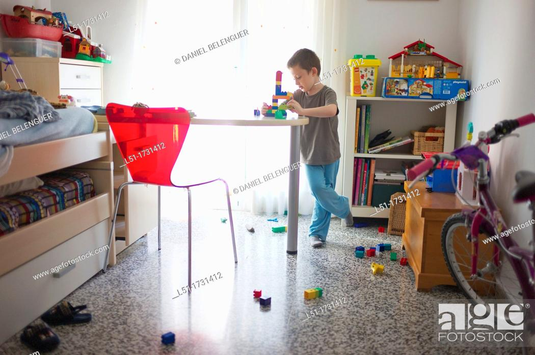 Stock Photo: boy playing in his bedroom, Valencia, Spain.