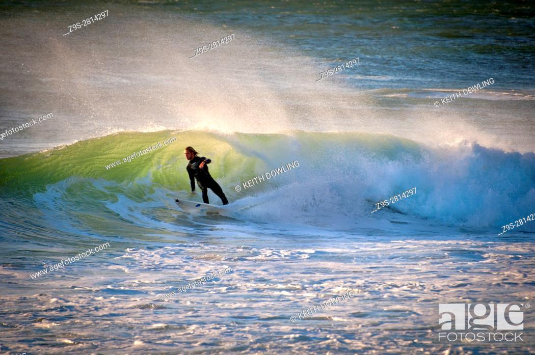 Stock Photo: Surfer emerges from Surf off The Cape coast, South Africa.
