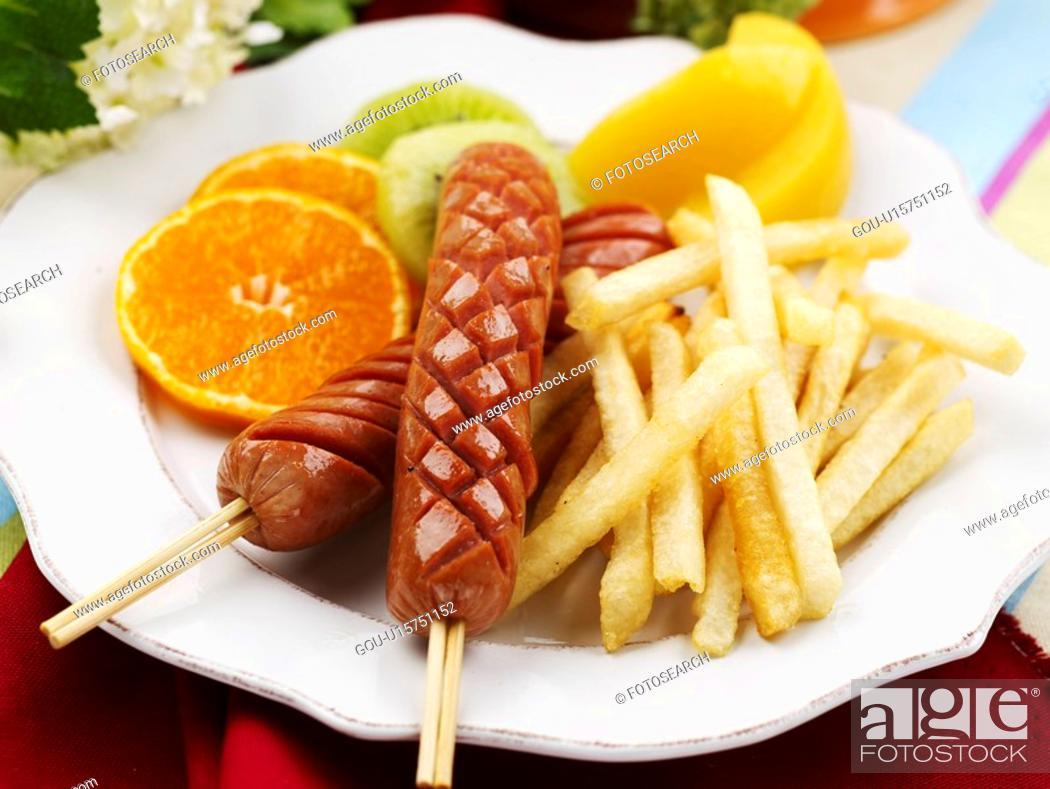 Stock Photo: tangerine, plate, kiwi, fruit, garnish, peach, sausage.