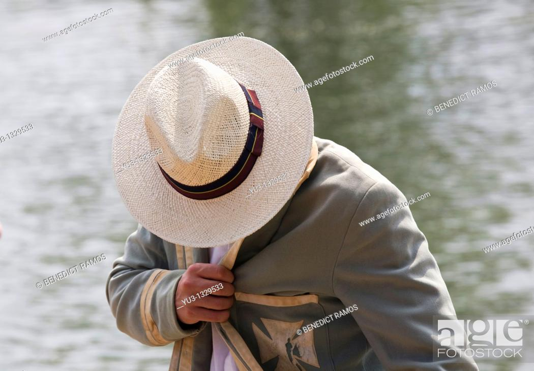 Stock Photo: Student spectator in panama hat and old college blazer during Oxford University Eights Week rowing competition, Oxford, England, UK.