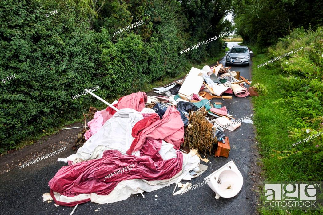 Stock Photo: England, Sussex, Fly Tipping on Small Rural Road.