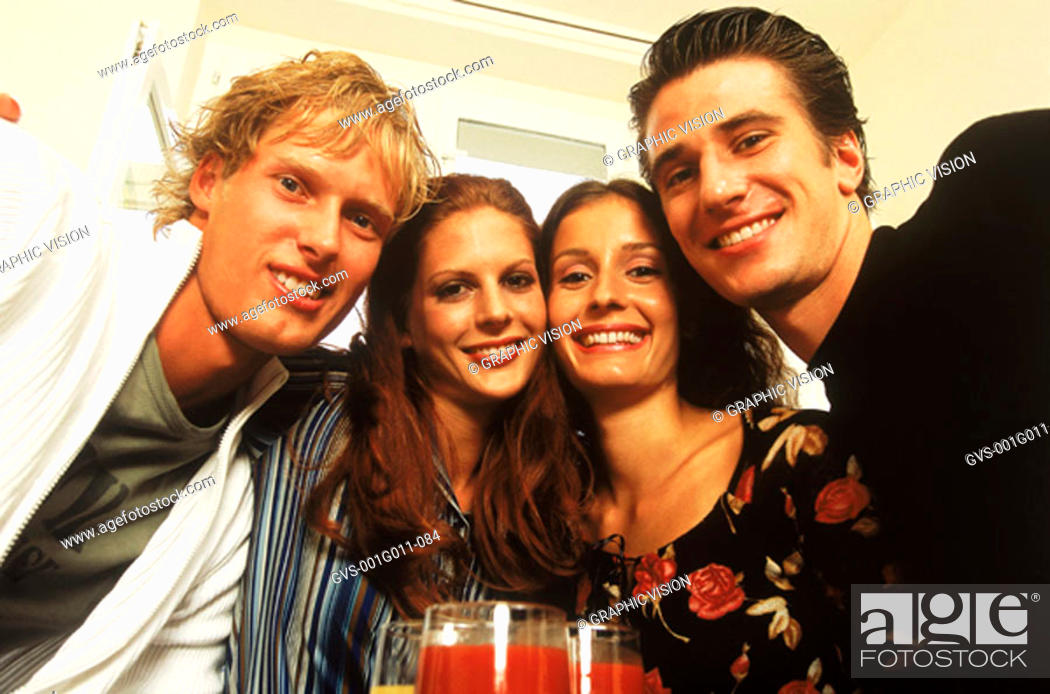 Stock Photo: Portrait of young group of people looking at camera.