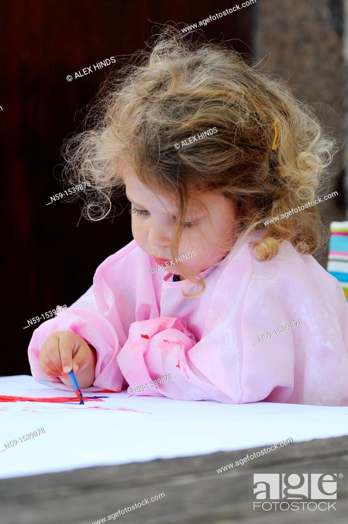 Stock Photo: Little girl painting.