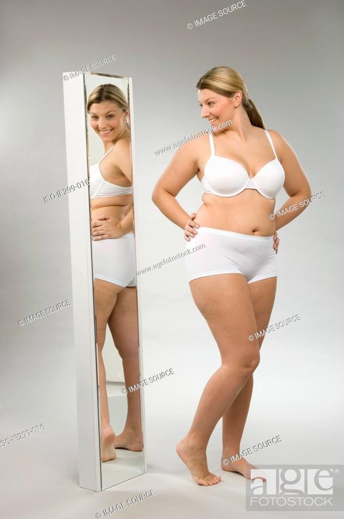 Stock Photo: A woman looking in a mirror.