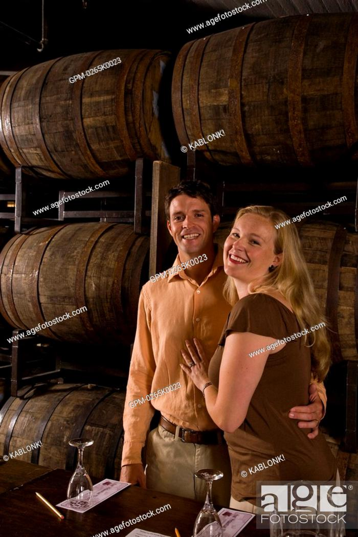Stock Photo: Couple on a wine tour and tasting.