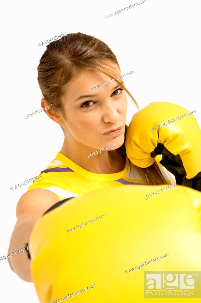 Stock Photo: Portrait of a female boxer in a boxing stance.