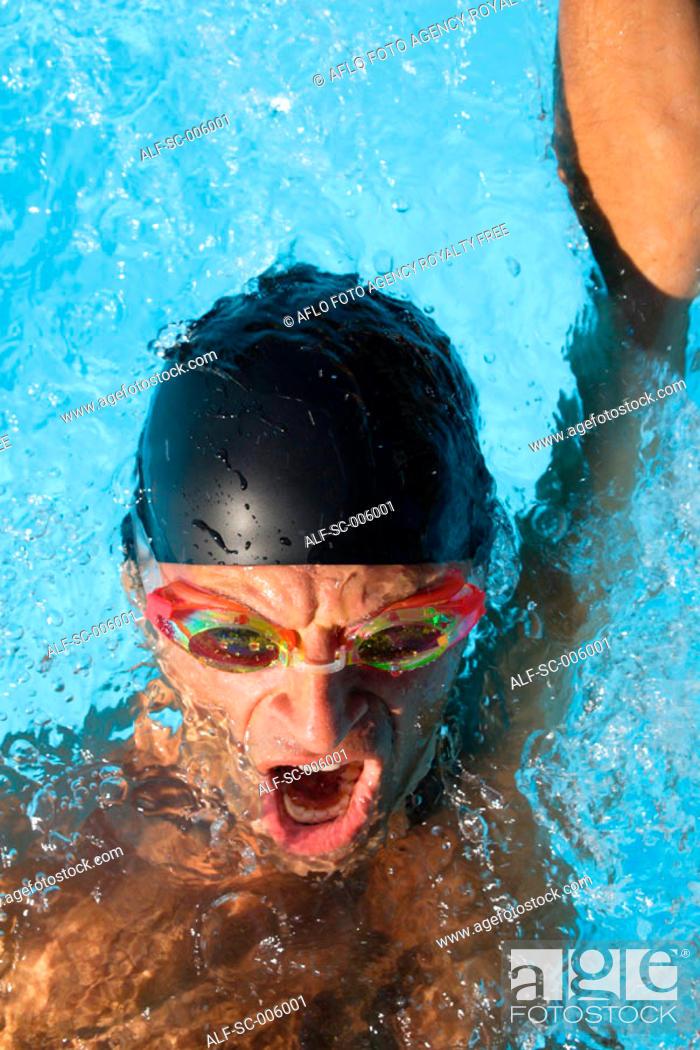 Stock Photo: Male Swimmer Swimming Backstroke.
