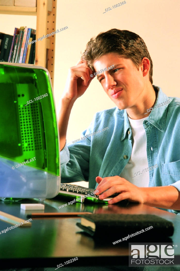 Stock Photo: Pupil in front of computer.