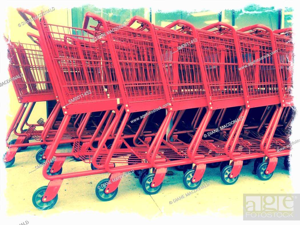 Stock Photo: A row of red shopping carts.
