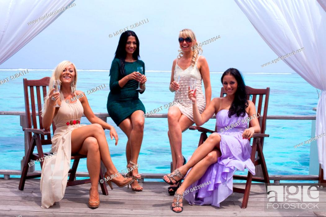 Stock Photo: Group girl on Maldives making party.
